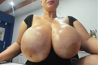 Huge Oiled Up Natural Tits